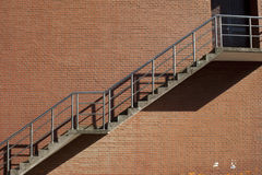 Steel stair on the red wall Royalty Free Stock Images