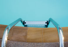 Steel stair in the swimming pool Royalty Free Stock Photo
