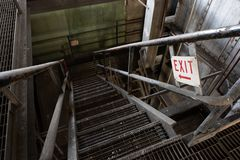 Steel Staircase with Exit Sign - Abandoned Coal Power Plant - New York stock image