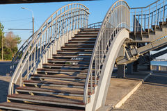 Steel staircase with wooden steps leading to the pedestrian brid Stock Images