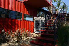 Steel stairs outside container-made caffeebar in sunny afternoon Royalty Free Stock Photos