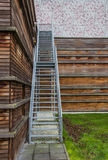 Steel stairs on a wooden building Stock Photos