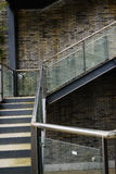 Steel stairway of gray brick building Royalty Free Stock Photos