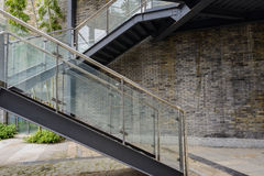 Steel stairway of newly built grey brick building Stock Image
