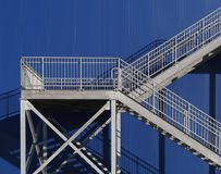 Steel Stairwell. Detail on blue exterior facade royalty free stock image