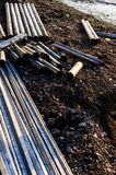Steel Stakes And Pipes On The Shore Stock Photos