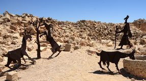Steel statues illustrate a typical scene at Avdat. Steel statues show a traveler watering his goats two thousand years ago at the UNESCO heritage site at the Stock Image