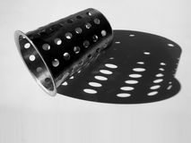 Steel strainer object. Holes & shadow abstract royalty free stock photo