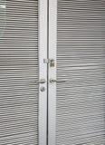 Steel stripped texture locked door Stock Images