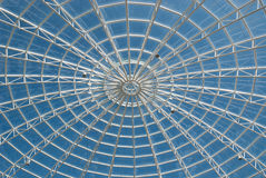 Steel structure. Coverage of a steel and glass building with sky background Stock Images