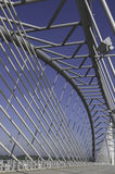 Steel structure bridge. Bridge with steel structure, cable-stayed suspension and curved circular hollow section steel bracing to strenghten the construction of Royalty Free Stock Photo