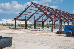 Steel structure factory. Steel structure of new industrial building under cloud blue sky. New technology structural frame beam of factory in construction. Steel Stock Image