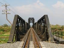 Steel structure of railway bridge, railway rail with vanishing point Stock Images