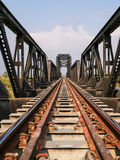 Steel structure of railway bridge, railway rail with vanishing point Royalty Free Stock Images