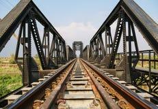 Steel structure of railway bridge, railway rail with vanishing point Royalty Free Stock Photo
