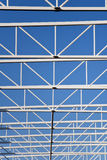 Steel structure of roof on the blue sky Stock Photography