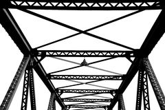 Steel structure support above the bridge in black and white Stock Image