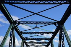 Steel structure support above the bridge on blue sky background Stock Images