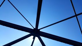 Steel structure support above the bridge on blue sky background Stock Photo