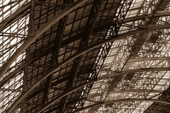 The steel structure of the train station roof over grey background Stock Photos
