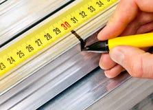 Steel stud measuring Royalty Free Stock Images