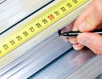 Steel stud measuring Stock Photo