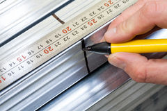 Steel stud measuring and marking Stock Image