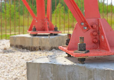 Steel support. Steel support on a concrete base. Piles held together by large bolts. Mounting the transmitter towers Stock Images