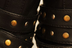 Steel support rivets on leather shoes macro Royalty Free Stock Photography