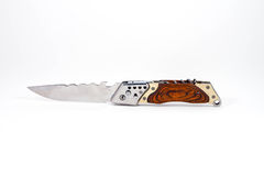 Steel switchblade knife with a wooden handle Royalty Free Stock Photography