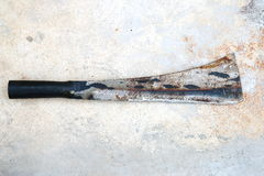 Steel sword with rust on cement floor Royalty Free Stock Photo