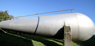 Steel tanks in the storage of flammable materials. Big steel tanks in the storage of flammable materials Stock Photo