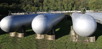 Steel tanks in the storage  of the industrial plant. Gigantic steel tanks in the storage of flammable materials of the industrial plant Royalty Free Stock Photography