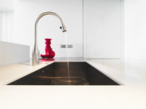Steel tap in modern kitchen Stock Photography