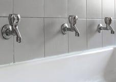 steel taps in the bathroom of kindergarten Stock Image