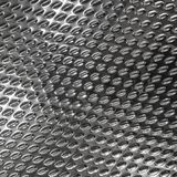 Steel texture background with rhombus and diamond shape. Brushed metal surface for industry. Textured royalty free stock photography