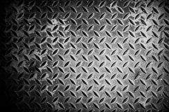 Steel texture from Manhole cover. Metallic background and wallpaper. Detail of Manhole cover pattern.Metal diamond plate pattern and background seamless Royalty Free Stock Image