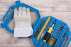 Steel toolset and working glove on a wooden table and working gl Stock Photos