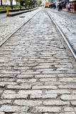 Steel Tracks In Cobblestone Street Stock Photography