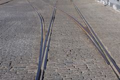 Steel tram tracks in an old cobblestone street royalty free stock photos