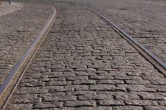 Steel tram tracks in an old cobblestone street stock photo