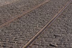 Steel tram tracks in an old cobblestone street royalty free stock images