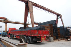 Steel transportation. In a steel storage factory with various steels royalty free stock images