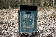 Steel trash bin in the forest Stock Image