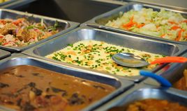Steel tray filled with food. Inside the self service Chinese restaurant royalty free stock photos