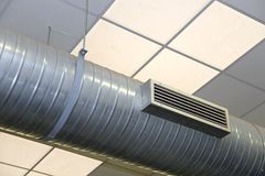 STEEL  tube of air conditioning and heating in an industrial sett. Big steel tube of air conditioning and heating Stock Image