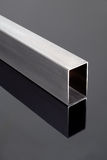 Steel tube on black surface Stock Photo