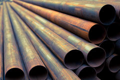 Steel tubes. Industrial iron pipes and steel tubes manufacturing fabric Stock Photos