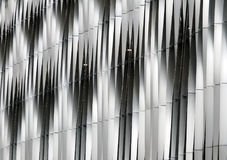 Steel vertical curved cladding modern hi-tech silver Stock Photos