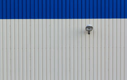 Steel wall with lamp Stock Photos